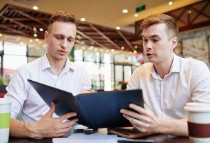 Business people reading menu