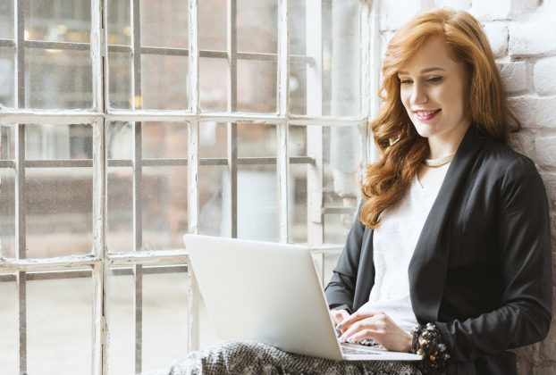 Freelance copywriter sitting on windowsill